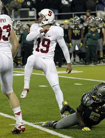 Jordan Williamson watches his kick go through the uprights to win Stanford's game at Oregon. Photo: Don Ryan, Associated Press