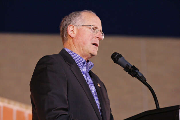U.S. Rep. Mike Conaway (R-TX) speaks during a candlelight vigil held at Centennial Plaza in downtown Midland, Tx., Saturday Nov. 17, 2012. The vigil was held to remember people involved in an accident where a Union Pacific train struck a float carrying military veterans,Thursday Nov. 15, 2012, killing four men, including one from the San Antonio area. Photo: Edward A. Ornelas, San Antonio Express-News / © 2012 San Antonio Express-News