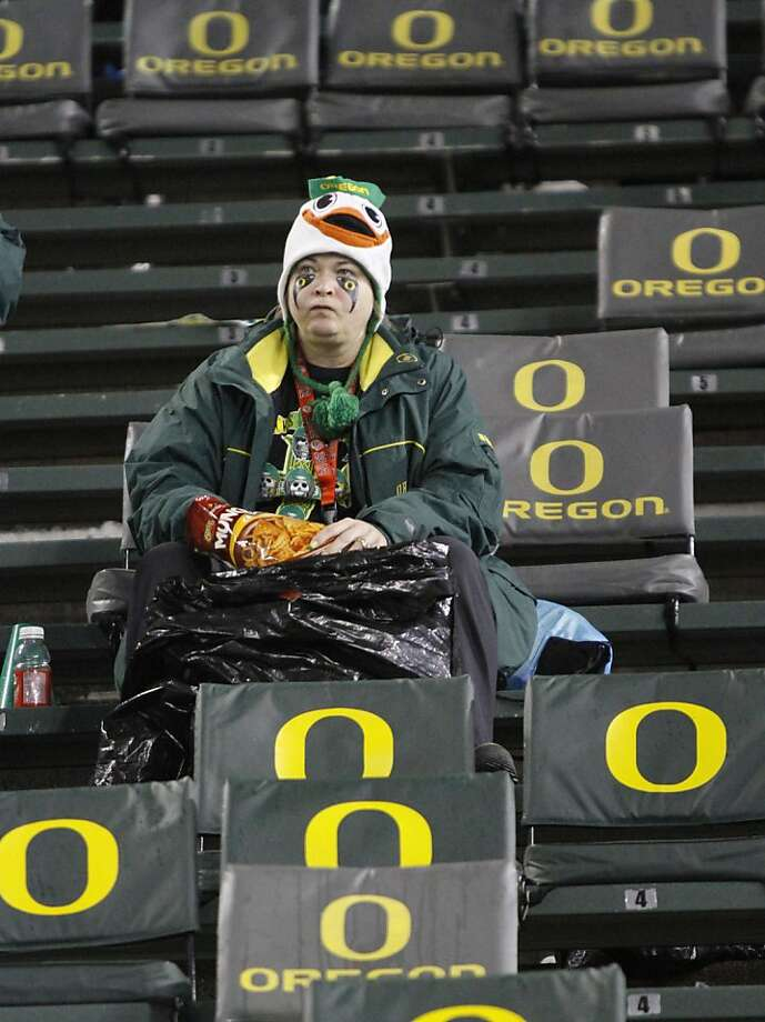 A lone Oregon fan sits in the stands after Oregon lost their NCAA college football game against Stanford in Eugene, Ore., Saturday, Nov. 17, 2012.  Stanford won 17-14 in overtime.(AP Photo/Don Ryan) Photo: Don Ryan, Associated Press