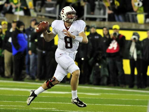 EUGENE, OR - NOVEMBER 17: Quarterback Kevin Hogan #8 of the Stanford Cardinal scrambles out of the pocket during the first quarter of the game against the Oregon Ducks at Autzen Stadium on November 17, 2012 in Eugene, Oregon. (Photo by Steve Dykes/Getty Images) Photo: Steve Dykes, Getty Images