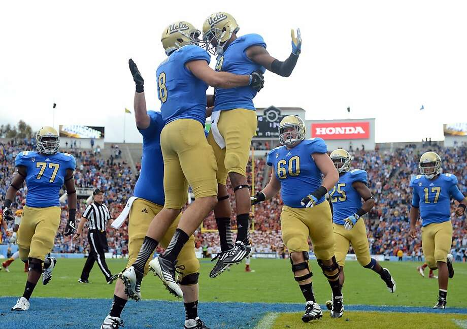 PASADENA, CA - NOVEMBER 17:  Joseph Fauria #8 of the UCLA Bruins celebrates his touchdown with Jerry Johnson #9 for a 17-0 lead over the USC Trojans at Rose Bowl on November 17, 2012 in Pasadena, California.  (Photo by Harry How/Getty Images) Photo: Harry How, Getty Images