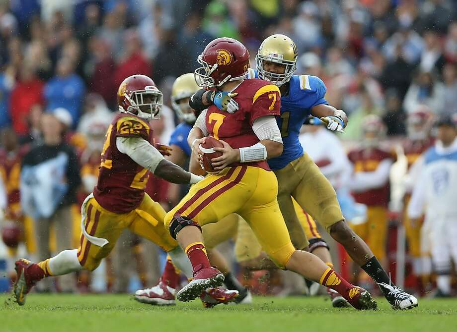 PASADENA, CA - NOVEMBER 17:  Quarterback Matt Barkley #7 of the USC Trojans is sacked by linebacker Anthony Barr #11 of the UCLA Bruins in the second half at the Rose Bowl on November 17, 2012 in Pasadena, California. UCLA defeated USC 38-28.  (Photo by Jeff Gross/Getty Images) Photo: Jeff Gross, Getty Images