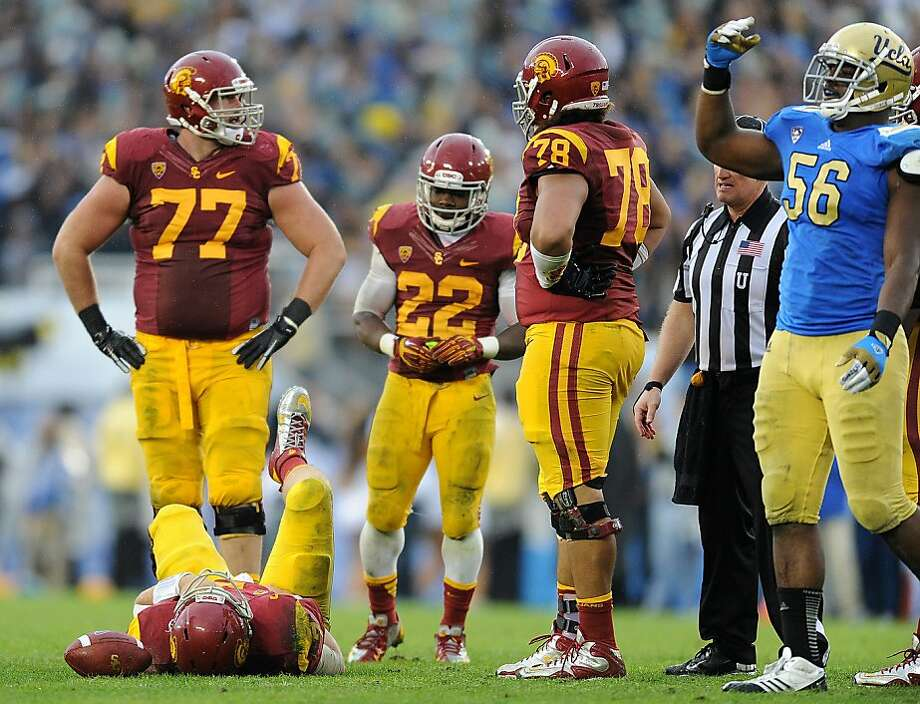 UCLA's Datone Jones calls for USC's medical staff as quarterback Matt Barkley lies injured after a sack in the fourth quarter at the Rose Bowl on Saturday, November 17, 2012, in Pasadena, California. UCLA knocked off USC, 38-28. (Wally Skalij/Los Angeles Times/MCT) Photo: Wally Skalij, McClatchy-Tribune News Service