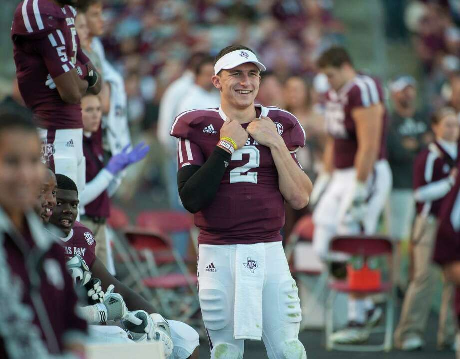 Texas A&M's Johnny Manziel (2) watches from the bench during the third quarter of an NCAA college football game against Sam Houston State, Saturday, Nov. 17, 2012, in College Station, Texas. (AP Photo/Dave Einsel) Photo: Dave Einsel, Associated Press / FR43584 AP