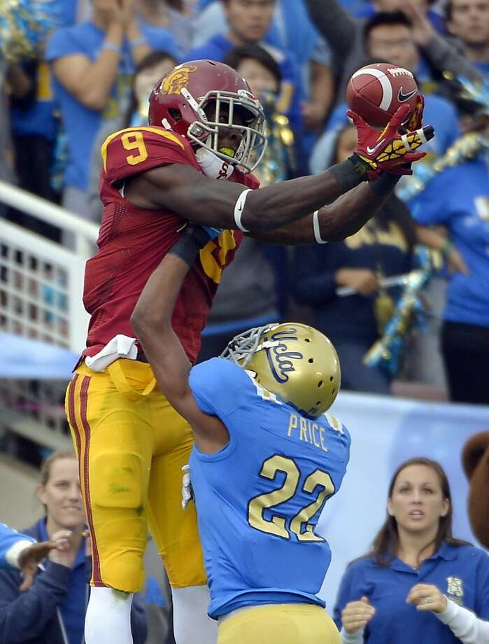 Southern California wide receiver Marqise Lee, left, can't hold on to a pass in the end zone as UCLA cornerback Sheldon Price defends during the first half of their NCAA college football game, Saturday, Nov. 17, 2012, in Pasadena, Calif. Price was called for pass interference on the play. (AP Photo/Mark J. Terrill) Photo: Mark J. Terrill, Associated Press