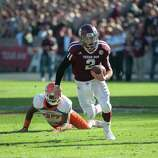 Texas A&M's Johnny Manziel (2) leaves Sam Houston State's Mike Littleton (27) behind on a run during the first quarter of an NCAA college football game, Saturday, Nov. 17, 2012, in College Station, Texas. (AP Photo/Dave Einsel)