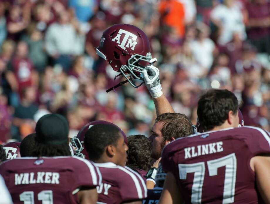 Texas A&M players huddle up before an NCAA college football game against Sam Houston State, Saturday, Nov. 17, 2012, in College Station, Texas. (AP Photo/Dave Einsel) Photo: Dave Einsel, Associated Press / FR43584 AP