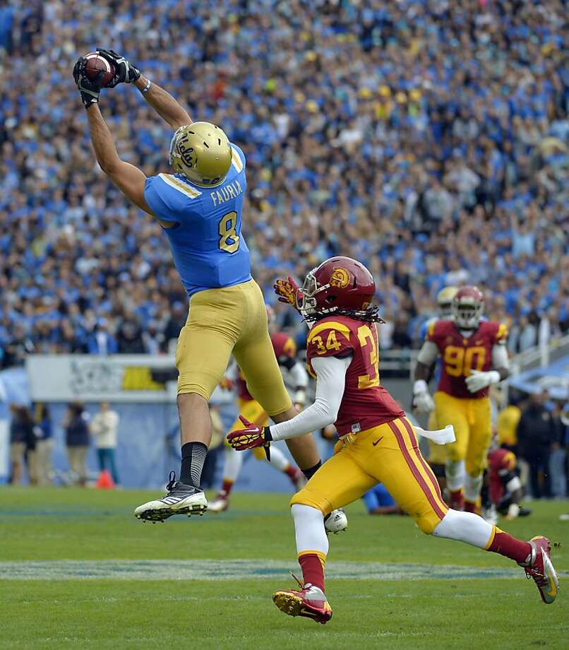 UCLA tight end Joseph Fauria makes a catch as Southern California linebacker Tony Burnett defends during the first half of their NCAA college football game, Saturday, Nov. 17, 2012, in Pasadena, Calif. (AP Photo/Mark J. Terrill) Photo: Mark J. Terrill, Associated Press