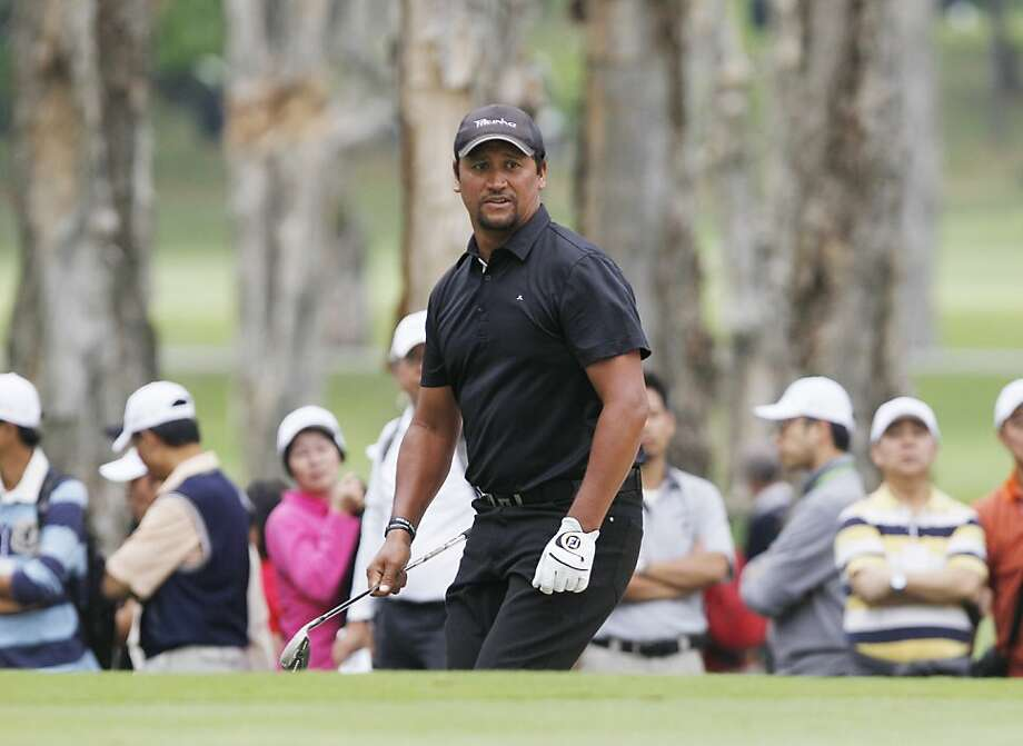 Michael Campbell of New Zealand watches the ball after hitting a bunker shot on the 9th hole during the Day 3 match of the 2012 UBS Hong Kong Open golf tournament in Hong Kong, Saturday, Nov. 17, 2012.  (AP Photo/Kin Cheung) Photo: Kin Cheung, Associated Press
