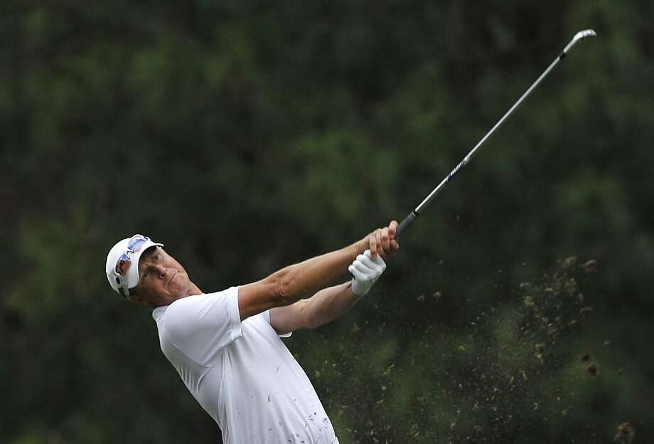 Fredrik Andersson Hed of Sweden hits a ball on the 18th hole during the Day 3 match of the 2012 UBS Hong Kong Open golf tournament in Hong Kong Saturday, Nov. 17, 2012. (AP Photo/Kin Cheung) Photo: Kin Cheung, Associated Press