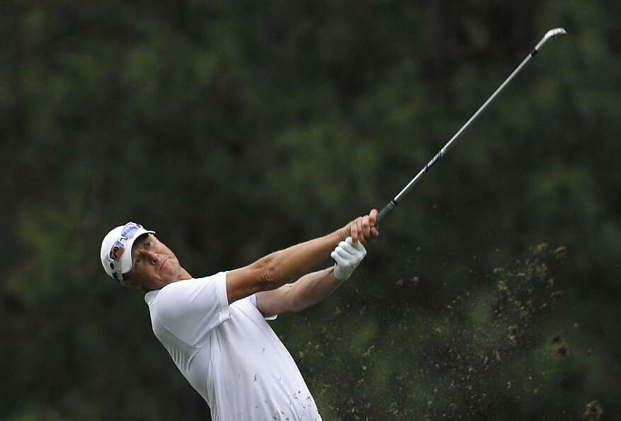 Fredrik Andersson Hed of Sweden hits a ball on the 18th hole during the Day 3 match of the 2012 UBS