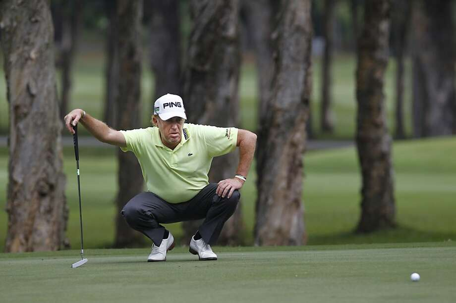 Miguel Angel Jimenez of Spain lines a putt on the 9th hole during the Day 3 match of the 2012 UBS Hong Kong Open golf tournament in Hong Kong Saturday, Nov. 17, 2012. (AP Photo/Kin Cheung) Photo: Kin Cheung, Associated Press