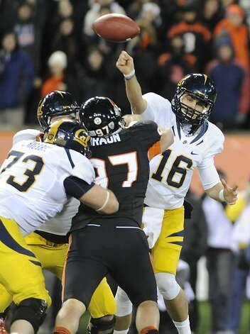 Oregon State's John Braun (97) obstructs Cal quarterback Allan Bridgford's pass in the first half. Photo: Greg Wahl-Stephens, Associated Press