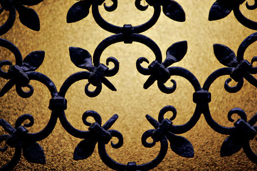 The San Pedro Park Branch Library is San Antonio's oldest branch library. It is one of 10 buildings recognized by the San Antonio Conservation Society for outstanding restoration. The building was designed by Atlee and Robert Ayres. Detail of front metal work shot on Wednesday, April 23, 2008. Photo: NICOLE FRUGE, SAN ANTONIO EXPRESS-NEWS / SAN ANTONIO EXPRESS-NEWS