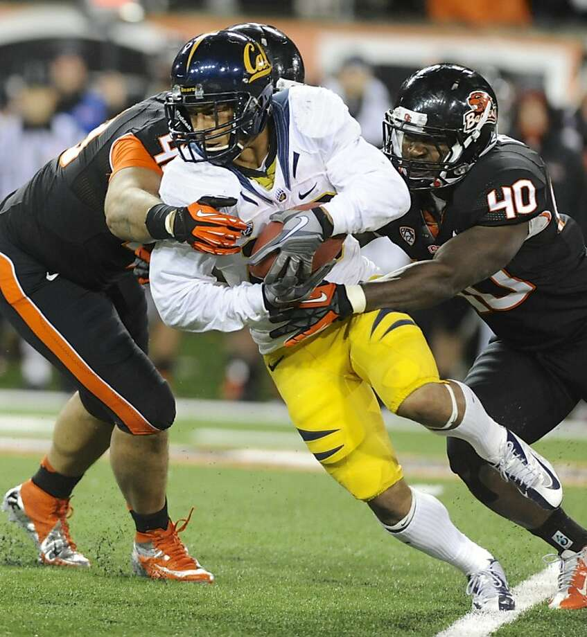 Oregon State's Michael Doctor (40) tackles California's Darius Powe (10) during the first half of an NCAA college football game in Corvallis, Ore., Saturday Nov.,17, 2012. (AP Photo/Greg Wahl-Stephens) Photo: Greg Wahl-Stephens, Associated Press