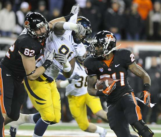 Oregon State Colby Prince (82) blocks for Storm Woods (24) against California's Deandre Coleman (91) during the first half of an NCAA college football game in Corvallis, Ore., Saturday Nov.,17, 2012. (AP Photo/Greg Wahl-Stephens) Photo: Greg Wahl-Stephens, Associated Press