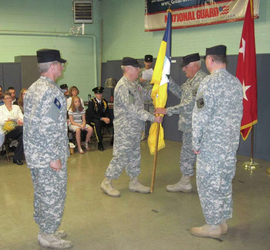 Nwe York Guard New York Guard Col. Brian Farley, center, out-going commander, passes the 10th Brigade flag to the Chief of Staff, Col. Larry Bishop during a change of command ceremony. Bishop then passed the flag to Col. David Molik, right, the new commander. Sgt. Maj. Thomas Czurlanis, left, participates in the ceremony.