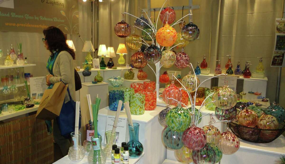 Rebecca Zhukov's Providence Art Glass booth at CraftWestport featured colorful ornaments, dispensers, decorative bottles and lamps. Westport CT 11/17/12