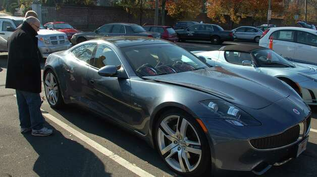 The Fisker is an $110,000 car with solar panels built into the roof. It was one of several vehicles shown at the Saugatuck Railroad Station on Saturday to raise awareness about electric cars.  Westport CT 11/17/12 Photo: Jarret Liotta / Westport News contributed