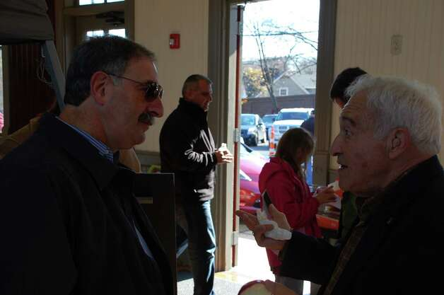 Leo Cirino, right, president of the Westport Electric Car Club, talks with state Rep. Jonathan Steinberg at Saturday's Electric Vehicle Demo Day. Steinberg serves on the legislature's Energy & Technology Committee. Westport CT 11/17/12 Photo: Jarret Liotta / Westport News contributed