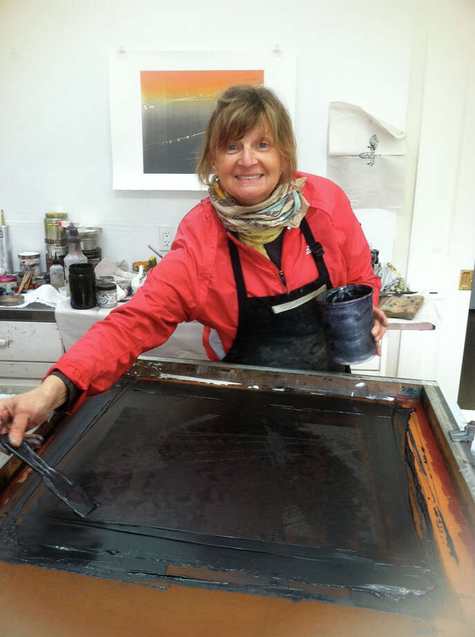 Roxanne Faber Savage, who will be teaching a two-workshop on printmaking at the Darien Arts Center, works with her favorite medium. Photo: Contributed