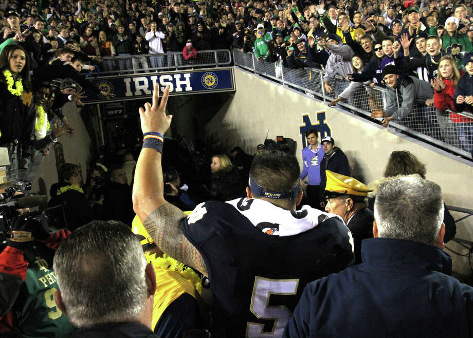 Notre Dame senior lineback Manti Te'o walks into the tunnel at Notre Dame stadium after a 38-0 win over Wake Forest Saturday Nov. 17, 2012 in South Bend, Ind. As a senior, it was Te'o's final home game. (AP Photo/The Goshen News, Sam Householder) Photo: Sam Housenholder, MBR / The News