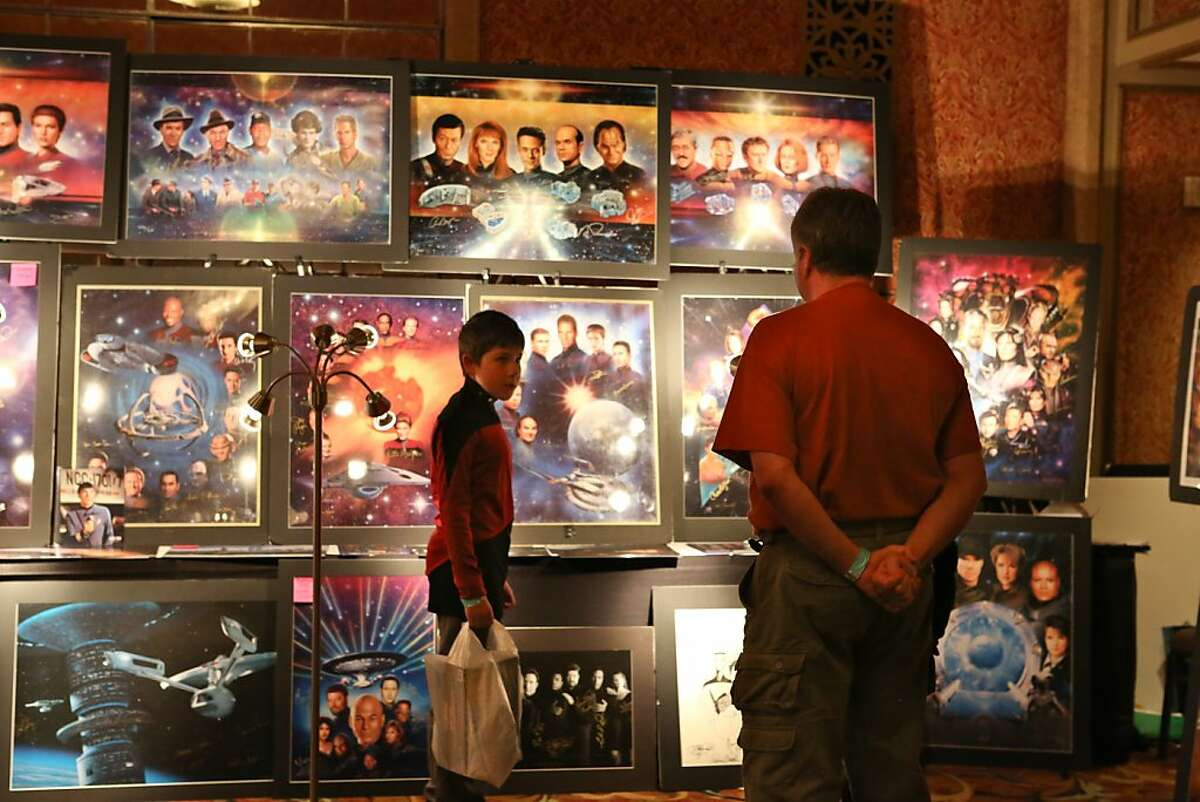 Tyler Massey and David Massey look at fan art during the Official Star Trek Convention in San Francisco at the Westin St. Francis.