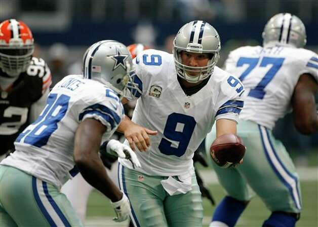 Dallas Cowboys quarterback Tony Romo (9) hands off to Felix Jones (28) in the opening series of an NFL football game against the Cleveland Browns Sunday, Nov. 18, 2012 in Arlington, Texas. (AP Photo/Brandon Wade) Photo: Brandon Wade, Associated Press / FR168019 AP