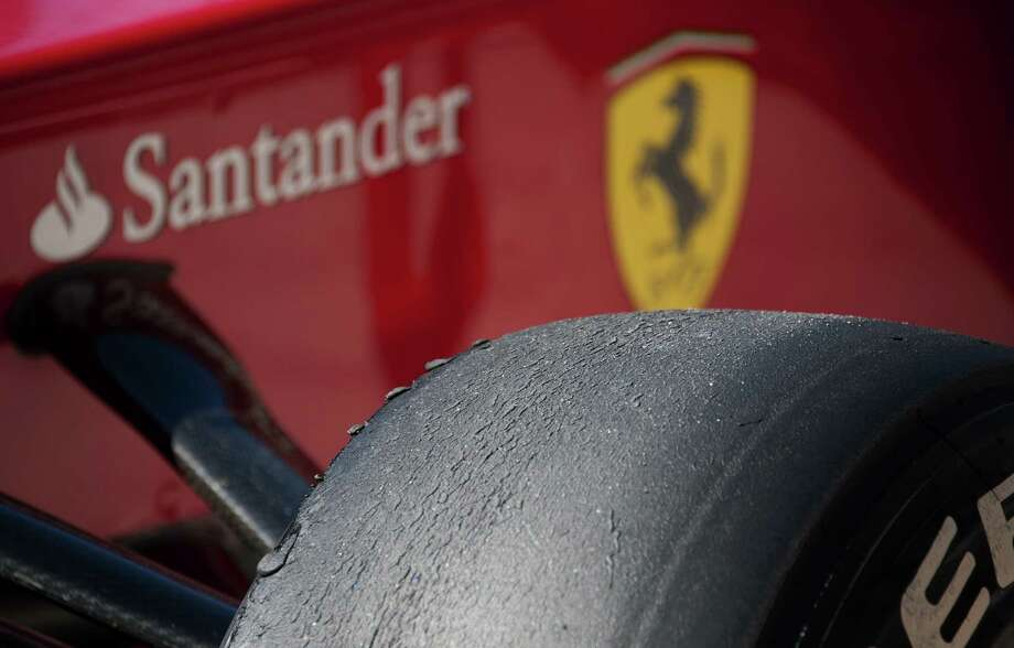 The front right tire of Spanish Ferrari Formula 1 driver Fernando Alonso's car is seen after the qualifying session for the United States Formula One Grand Prix at the Circuit of the Americas on November 17, 2012 in Austin, Texas.    AFP PHOTO/Jim WATSONJIM WATSON/AFP/Getty Images Photo: JIM WATSON, AFP/Getty Images / AFP