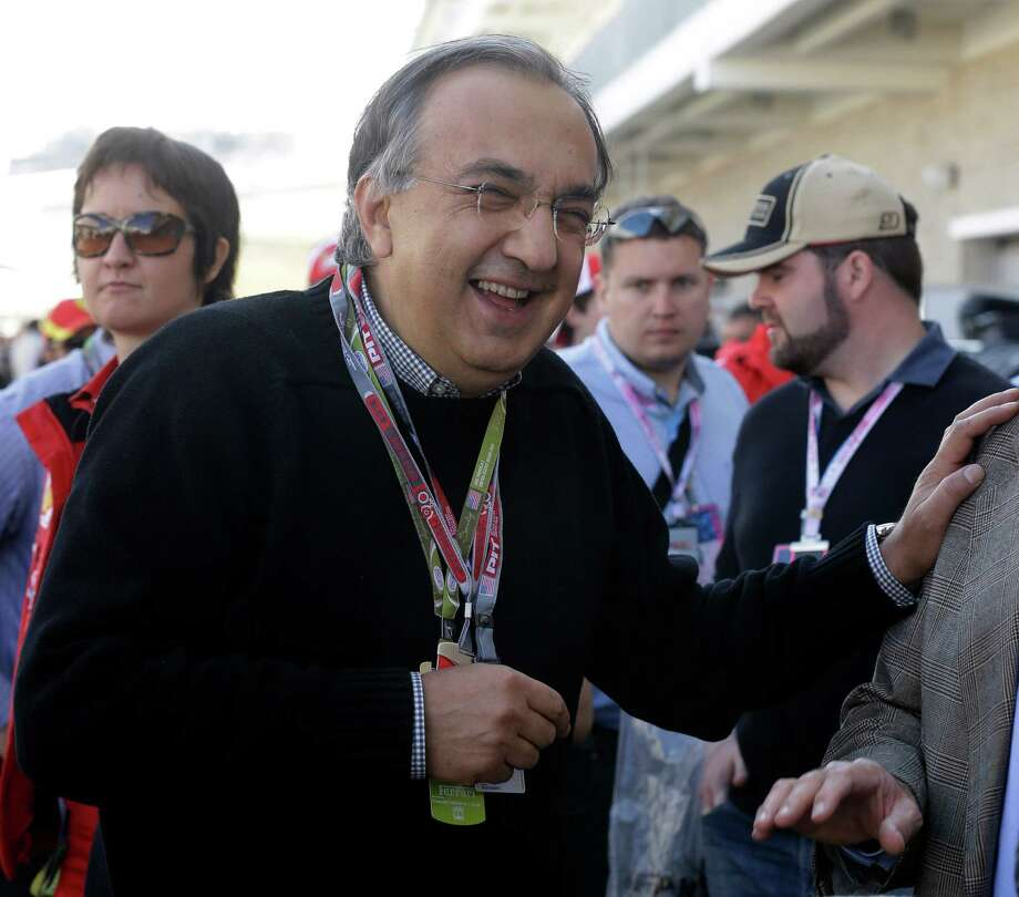 Fiat CEO Sergio Marchionne smiles as he walks in the paddock prior to the start of the Formula One U.S. Grand Prix auto race, at the Circuit of the Americas race track, in Austin, Texas, Sunday, Nov. 18, 2012. (AP Photo/Luca Bruno) Photo: Luca Bruno, Associated Press / AP