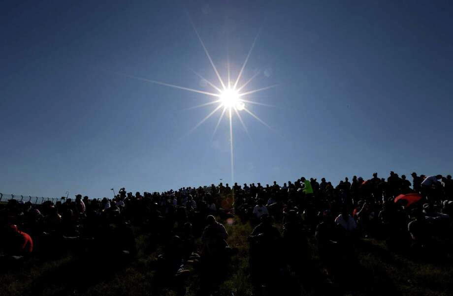 Fans wait for the running of the first Formula One U.S. Grand Prix auto race at the Circuit of the Americas Sunday, Nov. 18, 2012, in Austin, Texas. (AP Photo/David J. Phillip) Photo: David J. Phillip, Associated Press / AP