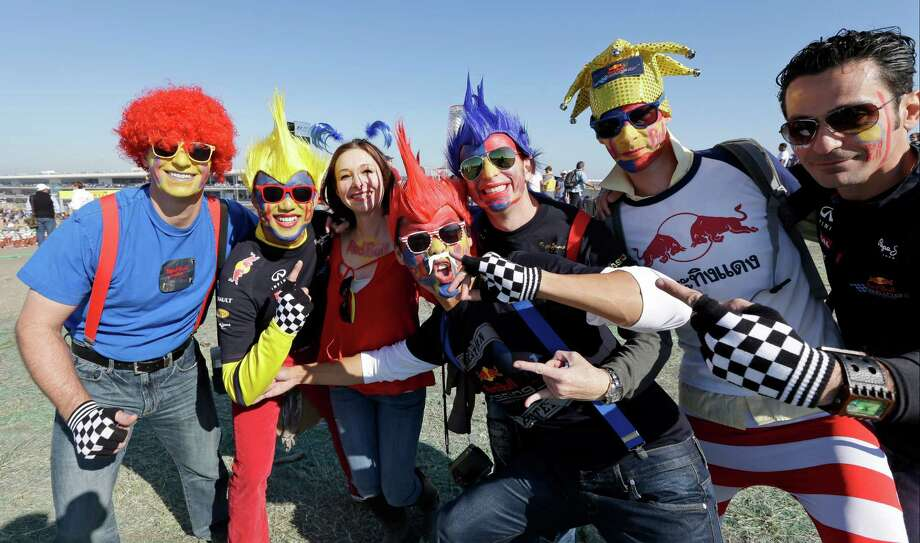 Fans from Austin, Texas celebrate before the running of the Formula One U.S. Grand Prix auto race at the Circuit of the Americas Sunday, Nov. 18, 2012, in Austin, Texas. (AP Photo/David J. Phillip) Photo: David J. Phillip, Associated Press / AP
