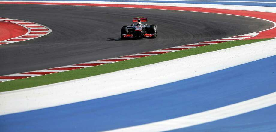 McLaren Mercedes driver Lewis Hamilton of Britain steers his car during the Formula One U.S. Grand Prix auto race at the Circuit of the Americas Sunday, Nov. 18, 2012, in Austin, Texas. (AP Photo/David J. Phillip) Photo: David J. Phillip, Associated Press / AP