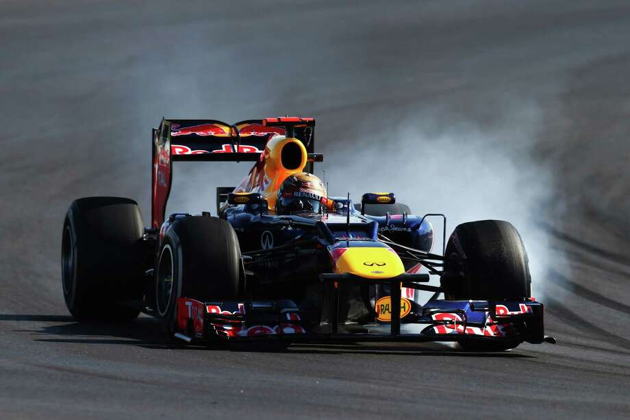 AUSTIN, TX - NOVEMBER 18:  Sebastian Vettel of Germany and Red Bull Racing locks his wheels during the United States Formula One Grand Prix at the Circuit of the Americas on November 18, 2012 in Austin, Texas. Photo: Clive Mason, Getty Images / 2012 Getty Images