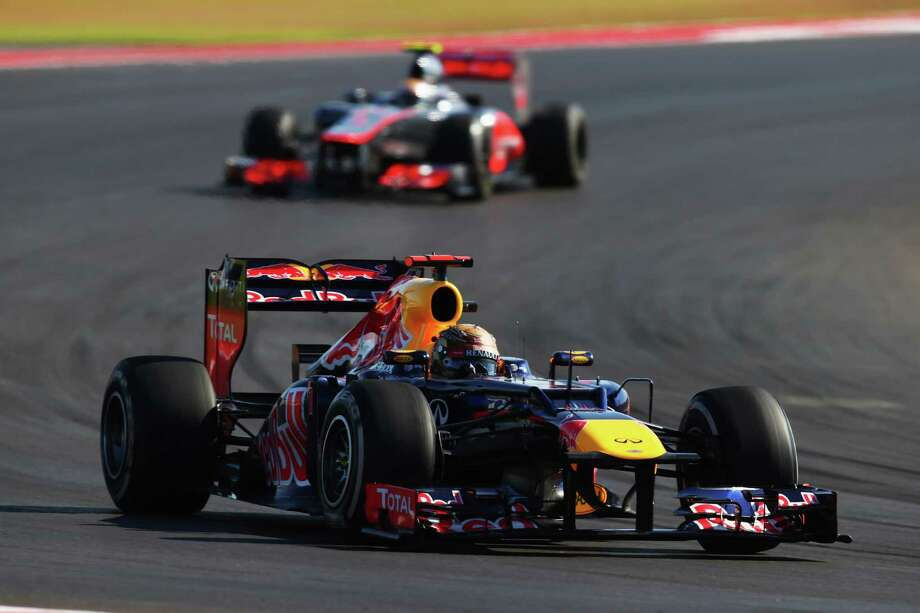 AUSTIN, TX - NOVEMBER 18:  Sebastian Vettel of Germany and Red Bull Racing leads from Lewis Hamilton of Great Britain and McLaren during the United States Formula One Grand Prix at the Circuit of the Americas on November 18, 2012 in Austin, Texas. Photo: Clive Mason, Getty Images / 2012 Getty Images