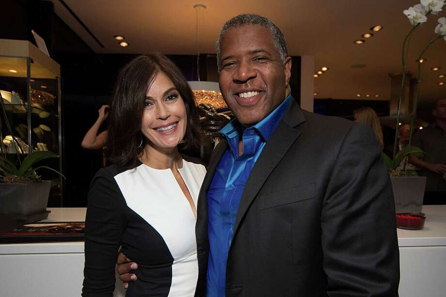 AUSTIN, TX - NOVEMBER 17:  Actress Teri Hatcher and Chairman and CEO of Vista Equity Partners Robert Smith attend the Laureus Austin Formula One cocktail party on November 17, 2012 in Austin, Texas. Photo: Rick Kern, Getty Images For Laureus / 2012 Getty Images
