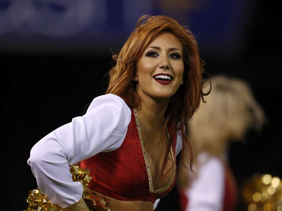 A 49ers cheerleader smiles during a game between the San Francisco 49ers and the visiting Detroit Lions at Candlestick Park in San Francisco, Calif. on Sunday, Sept. 16, 2012. Photo: Stephen Lam, Special To The Chronicle / ONLINE_YES