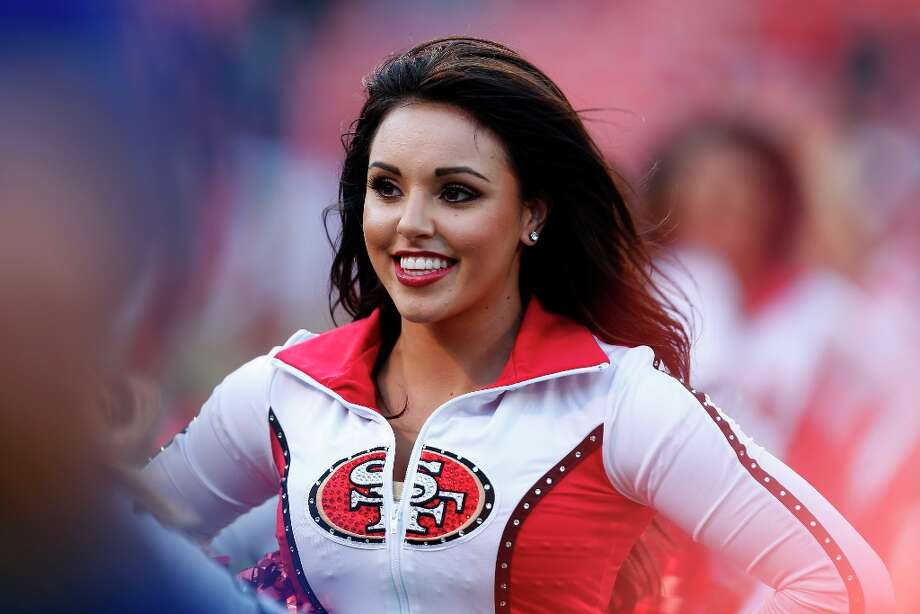 A cheerleader leaves the field during a preseason game between the San Francisco 49ers and the visiting San Diego Chargers at Candlestick Park in San Francisco, Calif. on Thursday, Aug. 30, 2012. Photo: Stephen Lam, Special To The Chronicle / ONLINE_YES