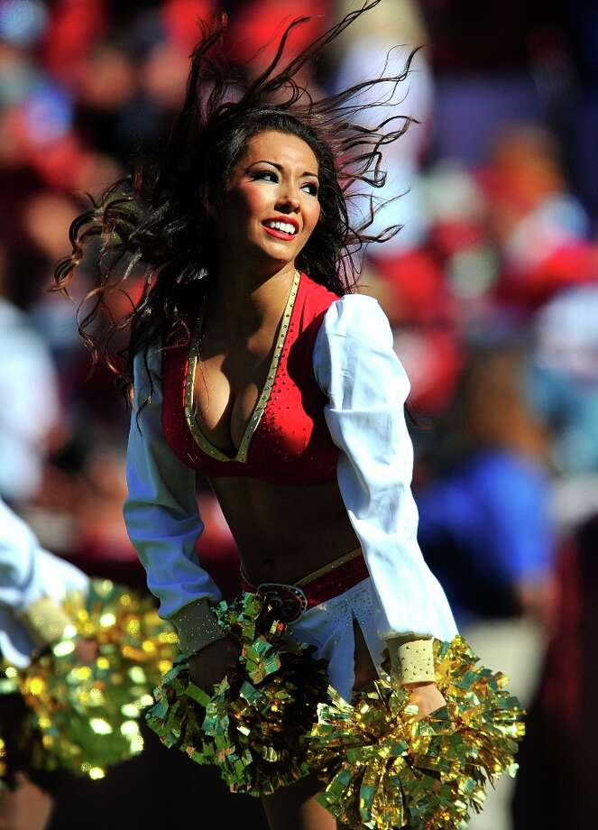 A San Francisco 49ers cheerleader performs during the second half of an NFL football game against the New York Giants in San Francisco, Sunday, Oct. 14, 2012. Photo: Don Feria, Associated Press / AP FR170768