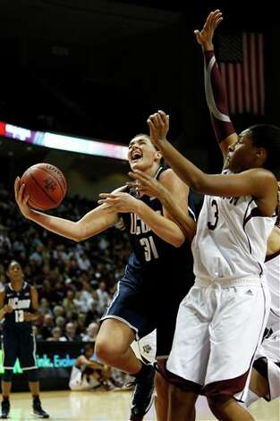 Connecticut's Stefanie Dolson (31) shoots the ball against Texas A&M defender Kelsey Bone (3) during the first half of a NCAA college basketball game on Sunday, Nov. 18, 2012, in College Station, Texas. (AP Photo/Jon Eilts)