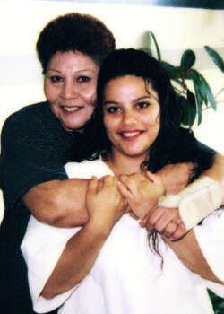 Gloria Herrera, left, and her daughter Elizabeth Ramirez in a photo taken during a visit in prison.  Photo: BOB OWEN, SAN ANTONIO EXPRESS-NEWS / SAN ANTONIO EXPRESS-NEWS