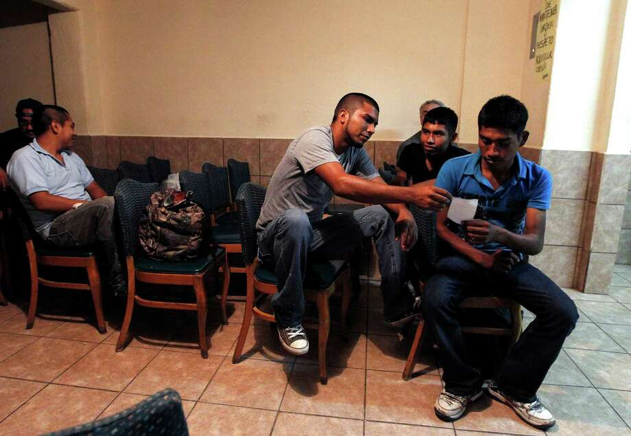 Several immigrants, many of them Mexican citizens, gather in a chapel area at a well known immigrant shelter, as many are making tough decisions on whether to try their luck by illegally crossing the U.S. border. Mexico needs a new approach to immgration, too. Photo: Ross D. Franklin, Associated Press / AP