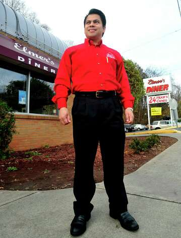 Elmer Palma stands outside his Danbury business, Elmer's Diner, Friday, Nov. 16, 2012. Palma serves as a member of the Danbury Zoning Commission. Photo: Michael Duffy
