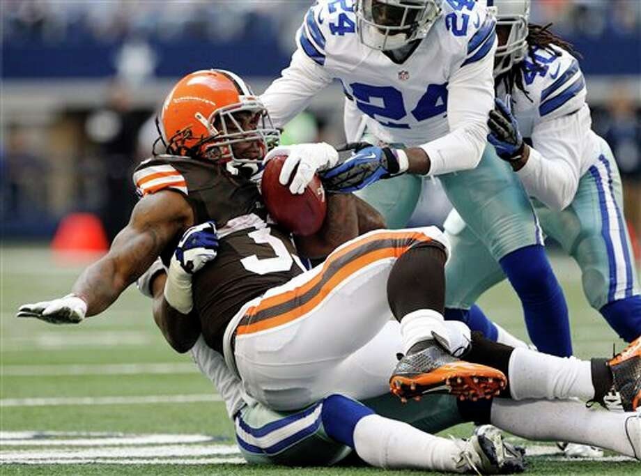 Dallas Cowboys' Bruce Carter, rear, Morris Claiborne (24) and Danny McCray (40) combine to stop a run by Cleveland Browns' Trent Richardson (33) in the second half of an NFL football game, Sunday, Nov. 18, 2012, in Arlington, Texas. (AP Photo/Brandon Wade) Photo: Brandon Wade, Associated Press / FR168019 AP