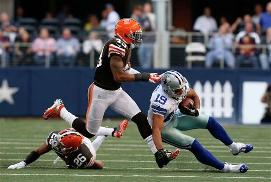 Cleveland Browns' Trevin Wade (26) and T.J. Ward (43) combine to bring down Dallas Cowboys' Miles Austin (19) following a reception by Austin in the second half of an NFL football game Sunday, Nov. 18, 2012, in Arlington, Texas. (AP Photo/Sharon Ellman) Photo: Sharon Ellman, Associated Press / FR170032 AP