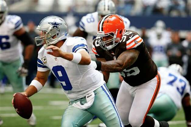 Dallas Cowboys' Tony Romo (9) is chased down and sacked by Cleveland Browns' Juqua Parker (95) in the first half of an NFL football game Sunday, Nov. 18, 2012 in Arlington, Texas. (AP Photo/Sharon Ellman) Photo: Sharon Ellman, Associated Press / FR170032 AP