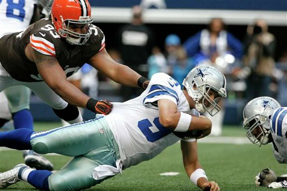 Dallas Cowboys' Tony Romo (9) is sacked by Cleveland Browns' John Hughes (93) in the first half of an NFL football game Sunday, Nov. 18, 2012 in Arlington, Texas. (AP Photo/Brandon Wade) Photo: Brandon Wade, Associated Press / FR168019 AP