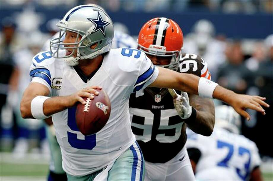 Dallas Cowboys quarterback Tony Romo (9) is chased down and sacked by Cleveland Browns' Juqua Parker (95) in the first half of an NFL football game, Sunday, Nov. 18, 2012 in Arlington, Texas. (AP Photo/Sharon Ellman), Photo: Sharon Ellman, Associated Press / FR170032 AP