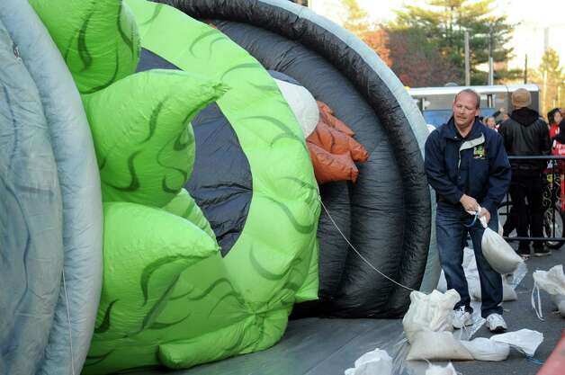 Oscar the Grouch is inflated during Saturday's Balloon Inflation Party near the intersection of Summer and Hoyt Streets in Stamford on November 17, 2012. Photo: Lindsay Niegelberg / Stamford Advocate