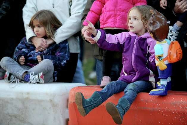 Emily Houle, 3, of New Canaan, right, points as Fred Flintsone is inflated during Saturday's Balloon Inflation Party near the intersection of Summer and Hoyt Streets in Stamford on November 17, 2012. Photo: Lindsay Niegelberg / Stamford Advocate